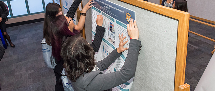 UC LEADS Scholars prepare their posters at the 2018 UC LEADS Symposium at UCSB